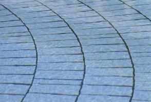 Las instrucciones sobre Colocación de las pavimentadoras del paisaje en un círculo