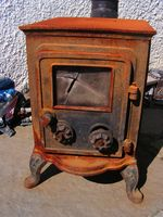 Cómo calentar una casa con una estufa de madera
