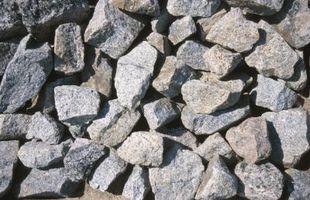 Asfalto Camino de entrada vs Piedra machacada