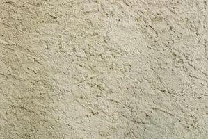 ¿Qué causa grietas de la pared de yeso?
