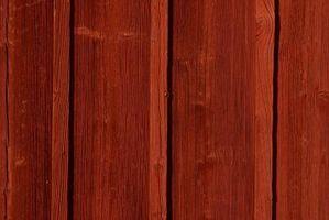 El lavado a presión de daños a los techos de madera de cedro