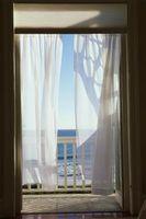 Cómo calcular las yardas para cortinas de cierre totalmente