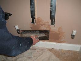 Cómo poner yeso en las paredes de fardos de paja