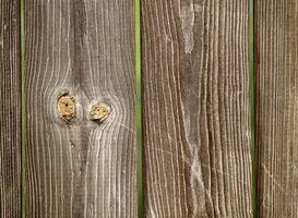Cómo utilizar Oxyclean para limpiar las tablas de madera de la cerca