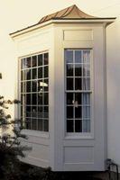 Cómo hacer una barra de la cortina para una ventana de arco