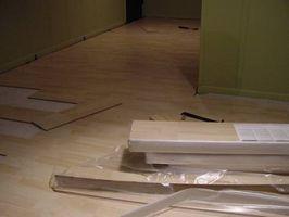 Cómo instalar juntos de Pergo pisos de madera dura