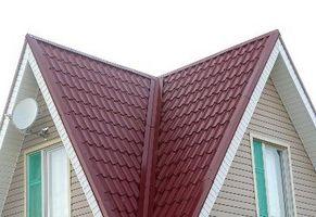 Cómo mejorar una casa prefabricada con un metal de tejado sobre tejas