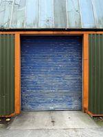 Cómo reemplazar un roto la puerta del garage del muelle de torsión
