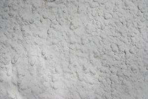Cómo arreglar grietas y agujeros en las paredes de yeso
